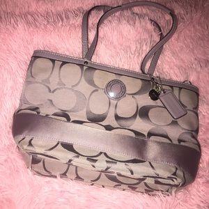 Coach bag. Slighty used. Still clean inside.